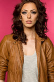 Beautiful young brunette in the leather jacket Royalty Free Stock Photography
