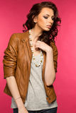 Beautiful young brunette in the leather jacket Royalty Free Stock Photos