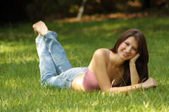 Beautiful Young Brunette Lying in Grass (1) Royalty Free Stock Images