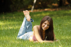 Beautiful Young Brunette Lying in Grass (2) Stock Images