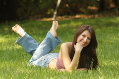 Beautiful Young Brunette Lying in Grass (3) Stock Photography