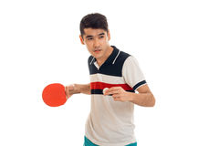 Beautiful young brunette man in uniform practicing table tennis isolated on white background Stock Photography