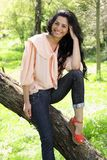 Beautiful young brunette model in the park Stock Image