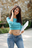 Beautiful Young Brunette with Notebook (2) Stock Photo