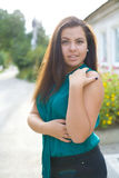 Beautiful young brunette outdoors Stock Photography