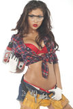 Beautiful young brunette in a plaid shirt. High fashion glamour model in Daisy duke shorts, tool belt, red bra with a screw gun Stock Photos
