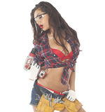 Beautiful young brunette in a plaid shirt Royalty Free Stock Photos