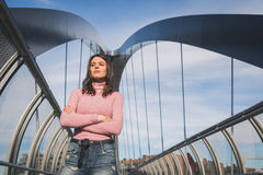 Beautiful young brunette posing on a bridge Royalty Free Stock Images