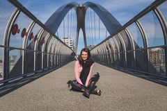 Beautiful young brunette posing on a bridge Royalty Free Stock Image