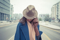 Beautiful young brunette posing in the city streets Royalty Free Stock Photo