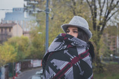 Beautiful young brunette posing in the city streets Stock Photography