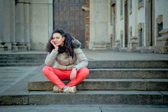 Beautiful young brunette posing in the city streets Royalty Free Stock Photos