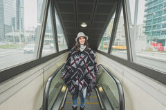 Beautiful young brunette posing on escalator Royalty Free Stock Images