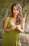Beautiful young brunette posing in green dress. Stock Photography