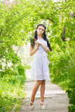 Beautiful young brunette posing in nature Royalty Free Stock Photo