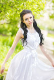 Beautiful young brunette posing in nature Stock Photo