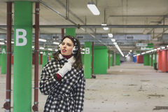 Beautiful young brunette posing in a parking garage Stock Photography