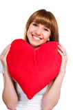 Beautiful young brunette with red heart Royalty Free Stock Image