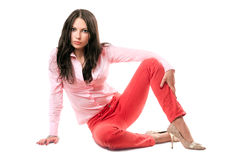 Beautiful young brunette in red jeans Stock Images