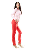 Beautiful young brunette in red jeans Stock Image