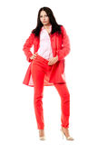 Beautiful young brunette in red suit Royalty Free Stock Images