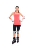 Beautiful young brunette on roller skates Royalty Free Stock Photography