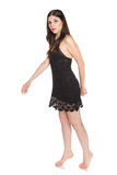 Beautiful young brunette in a short black dress Royalty Free Stock Image