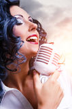 Beautiful young brunette singing Stock Photos