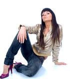 Beautiful young brunette sitting Royalty Free Stock Photos
