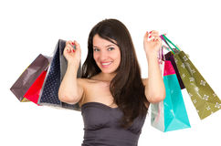 Beautiful young brunette smiling woman shopping Royalty Free Stock Photo