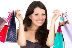 Beautiful young brunette smiling woman shopping Royalty Free Stock Image