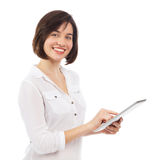 Beautiful young brunette surfing an electronic tablet Stock Photography