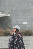 Beautiful young brunette talking on phone in the city streets Stock Photography