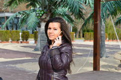 Beautiful young  brunette talking at the phone Stock Photography
