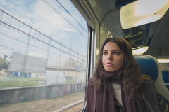 Beautiful young brunette travelling by train Stock Images