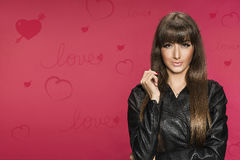 Beautiful young brunette valentines background. Beautiful young brunette valentines pink background Stock Photo