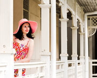Beautiful young brunette in vintage hotel Stock Photography