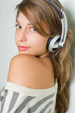 Beautiful young brunette wearing headphones Royalty Free Stock Images