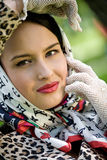 Beautiful young brunette wearing kerchief Royalty Free Stock Photos