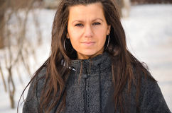 Beautiful young  brunette in the winter Royalty Free Stock Photos