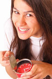 Beautiful young brunette woman with alarm clock Royalty Free Stock Photos