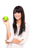 Beautiful young brunette woman with apple on white background Stock Image