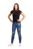 Beautiful young brunette woman with arms on her hips. Royalty Free Stock Photos