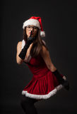 Beautiful young brunette woman with black retro glasses dressed as Santa Stock Photo