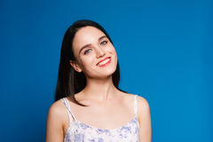 Beautiful young brunette woman on a blue background in the studio. Beautiful brunette woman on a blue background in the studio royalty free stock photography