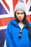 Beautiful young brunette woman with british flag Stock Photography