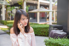 Beautiful young brunette woman calling by phone in shop. Beautiful young brunette woman calling by phone in the shop Royalty Free Stock Images
