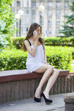 Beautiful young brunette woman calling by phone Stock Photos