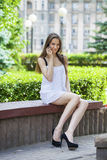 Beautiful young brunette woman calling by phone Royalty Free Stock Photo