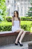 Beautiful young brunette woman calling by phone Royalty Free Stock Photography